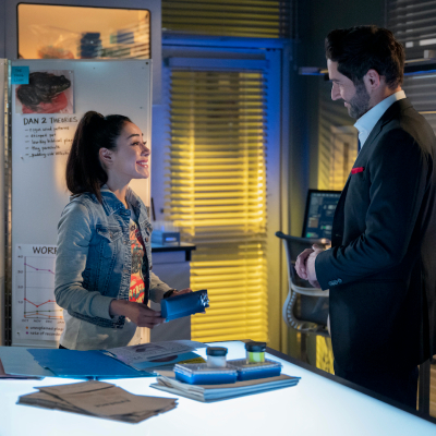 Aimee Garcia as forensic scientist Ella Lopez consults with Tom Ellis' Lucifer Morningstar.