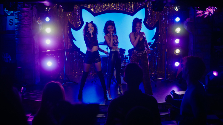 """Riverdale -- """"Chapter Ninety-One: The Return of The Pussycats"""" -- Image Number: RVD515fg_0047r -- Pictured (L-R): Hayley Law as Valerie Brown, Ashleigh Murray as Josie McCoy and Asha Bromfield as Melody Valentine -- Photo: The CW -- © 2021 The CW Network, LLC. All Rights Reserved."""