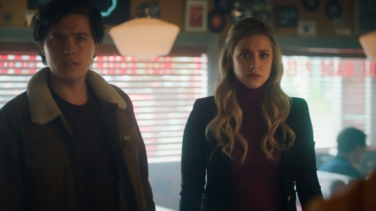 Cole Sprouse as Jughead Jones and Lili Reinhart as Betty Cooper on Riverdale Season 5 Episode 17 - Chapter 93: Dance of Death