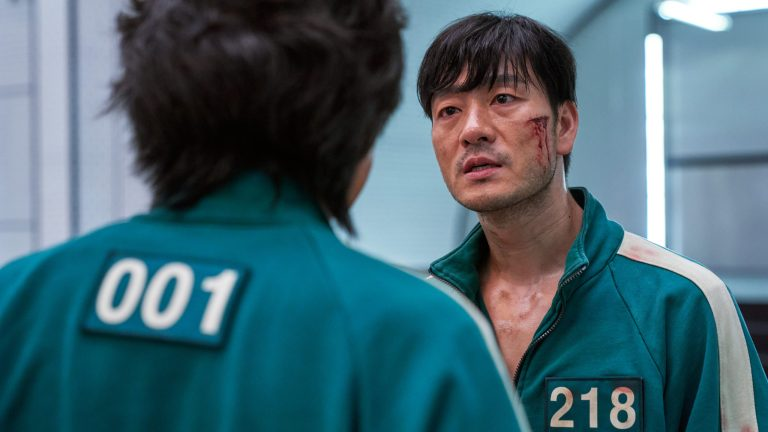 Gi-hun and Sang-woo face off in the Squid Game ending