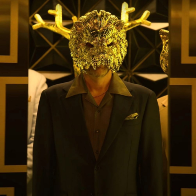 One of Squid Game's VIPs in a gold animal mask