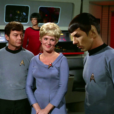 McCoy, Chapel, and Spock on the bridge of the Enterprise, as Uhura stands in the background on Star Trek